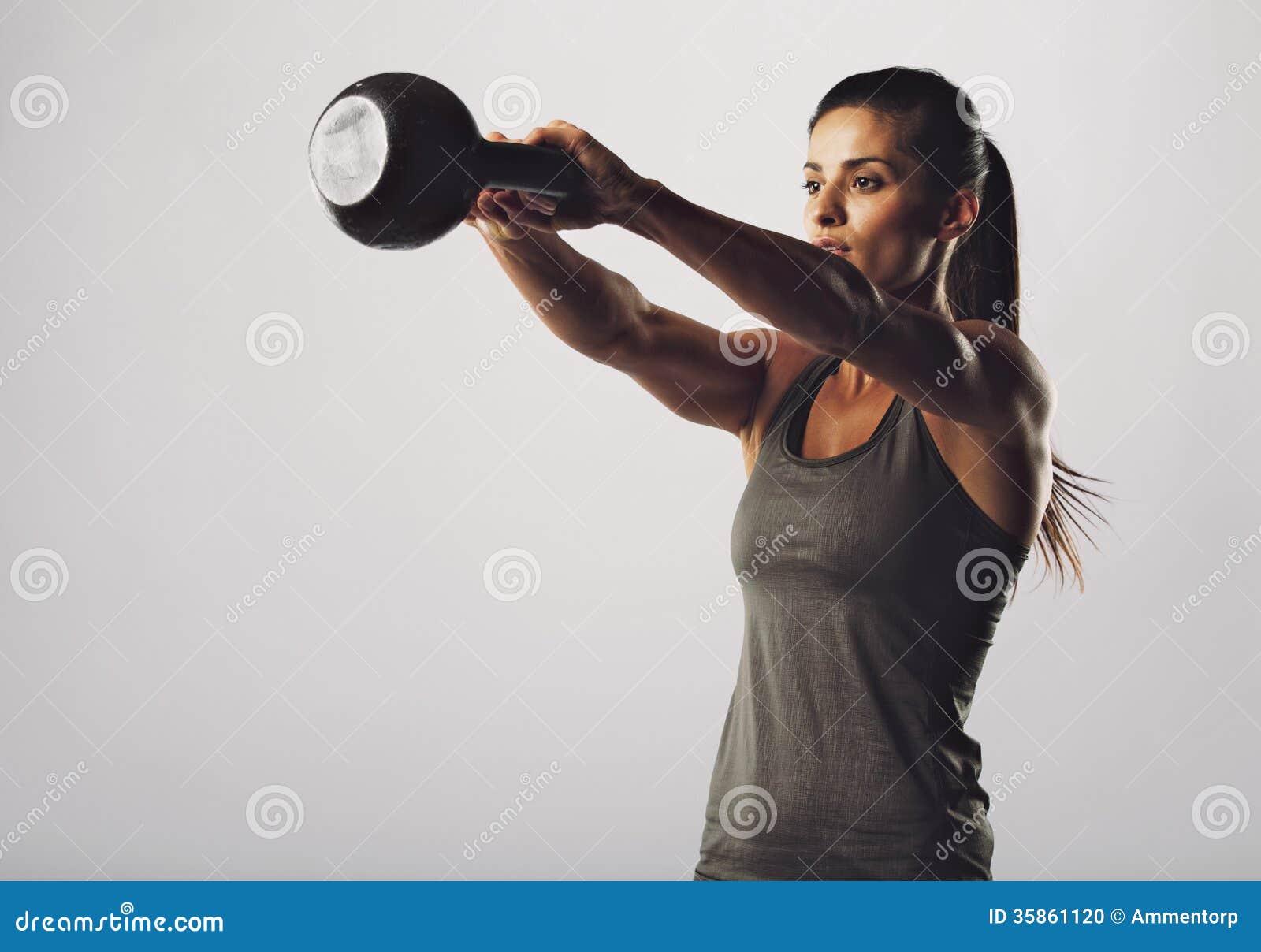 Attractive female doing kettle bell exercise stock photo - Wallpaper fitness women ...