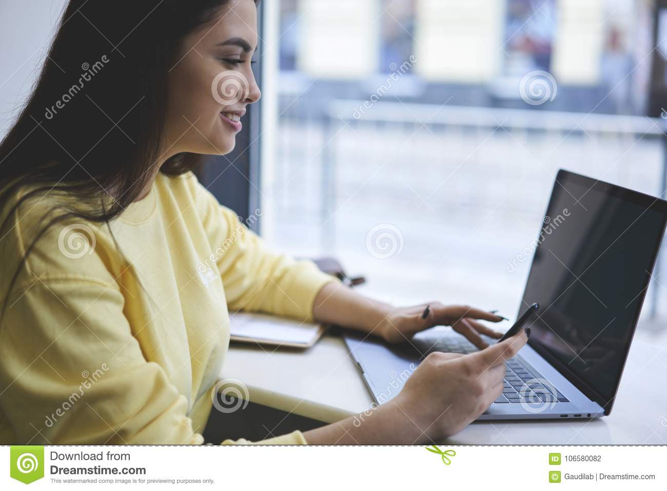 Young Hipster Girl Browsing Internet Via Portable Netbook And Modern Smartphone Sitting In Coffee Shop Stock Photo Image Of Application Journalist 106580082