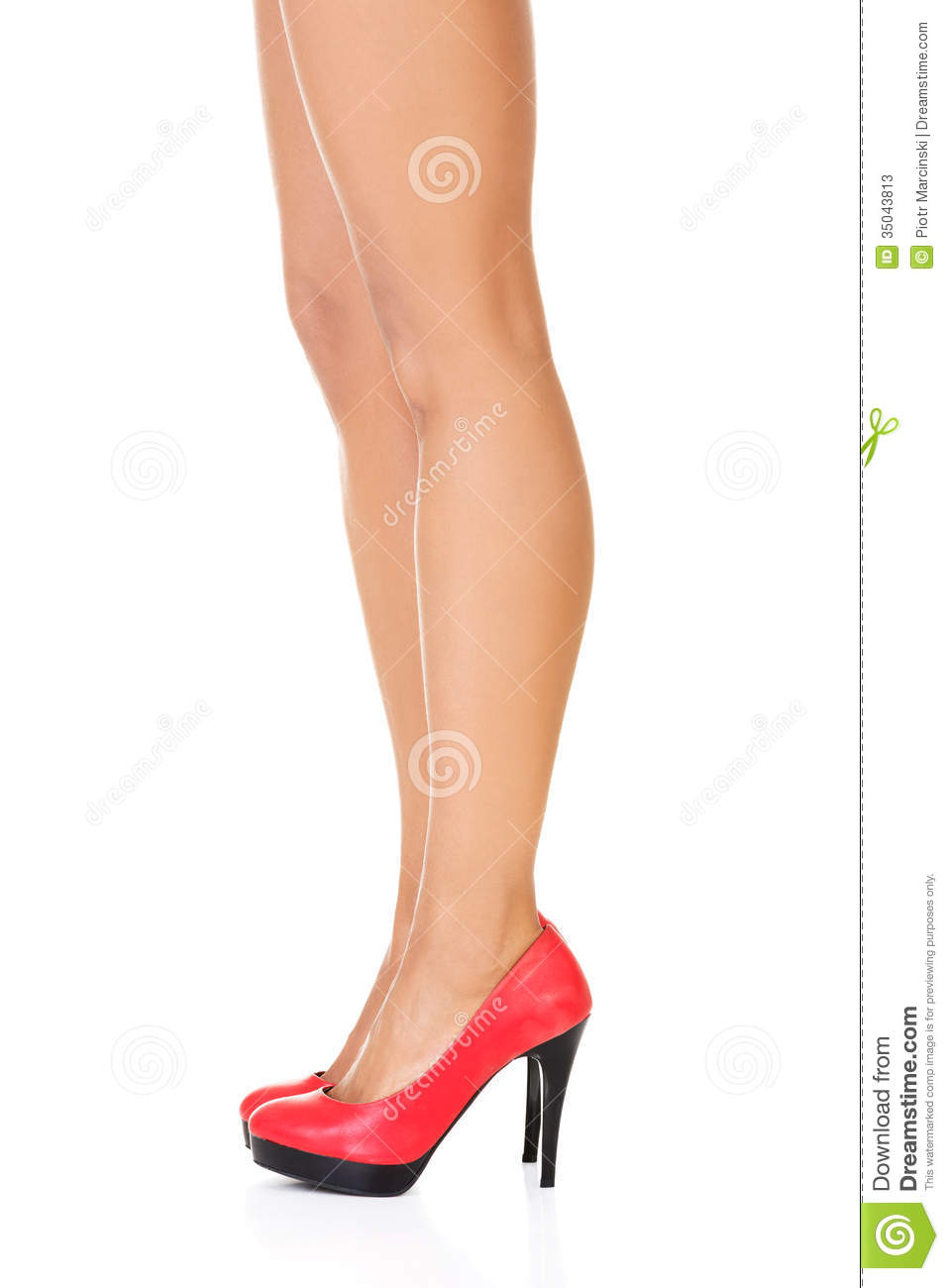 Attractive female legs in red high heels stock photos image