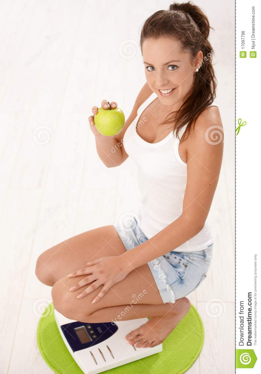 Attractive female scale smiling squatting young