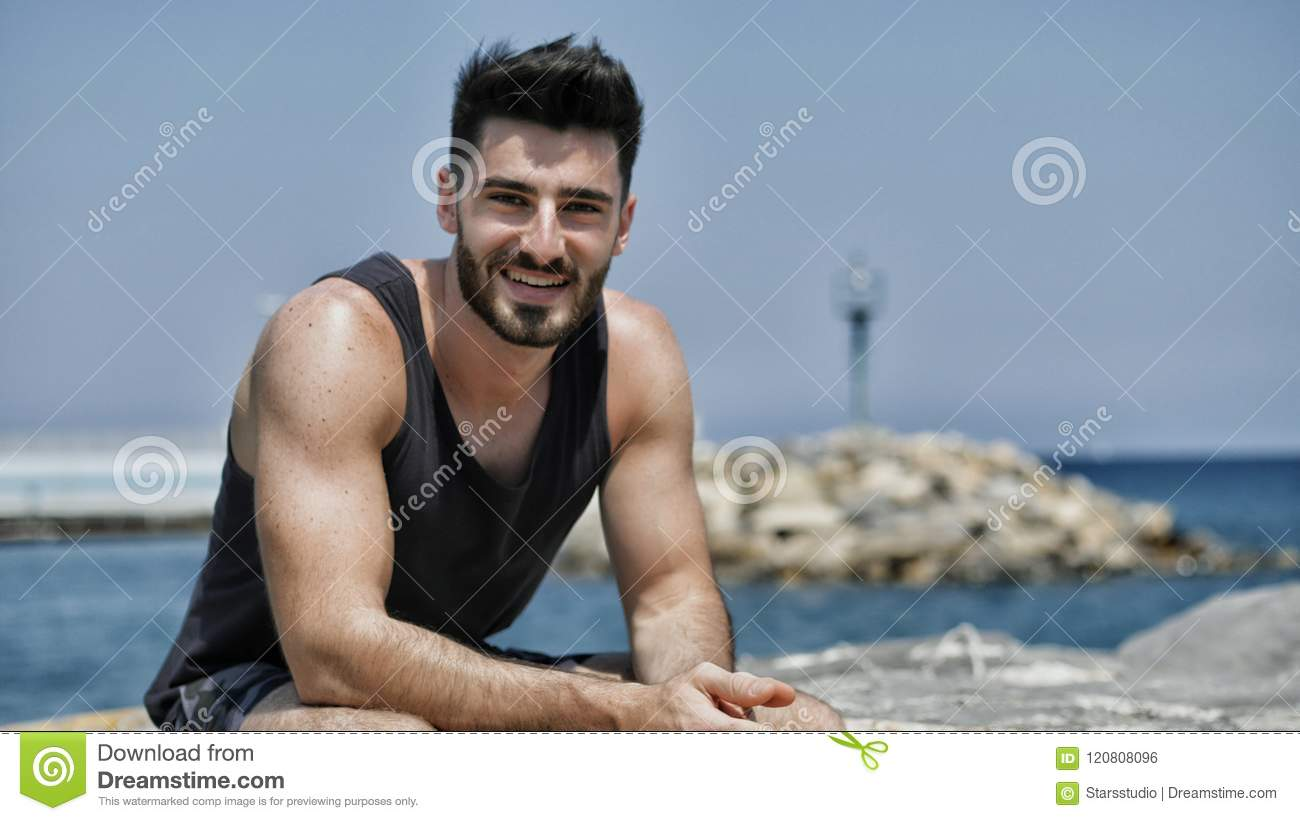 7aca6d90688be Attractive Athletic Young Man On Seaside Promenade Stock Photo ...
