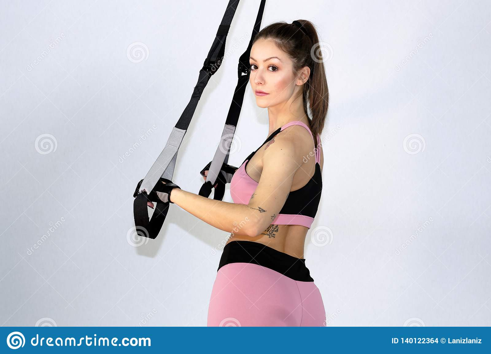 Attractive fitness woman, trained female body,Attractive fitness woman with top and mp3 player, caucasian lifestyle portrait, cauc