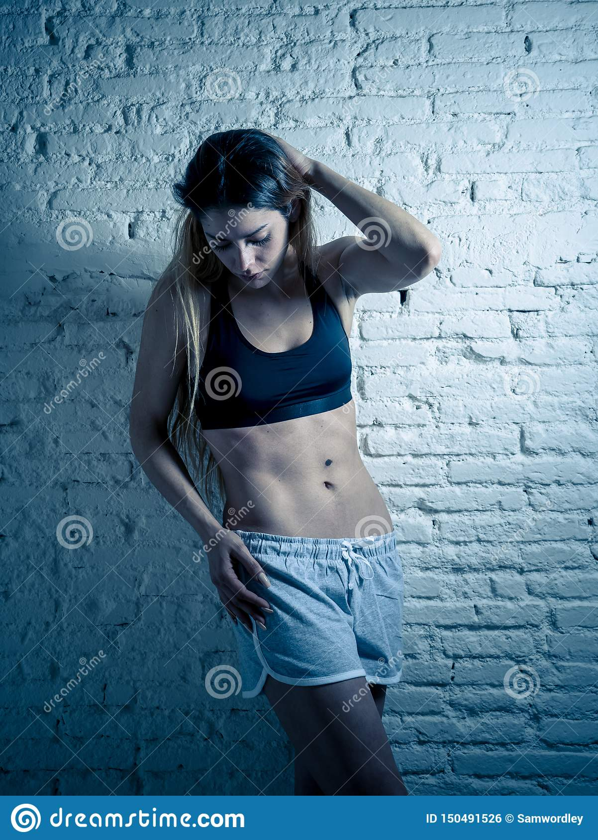 Adreano portrait of sporty beautiful woman in sport clothes looking
