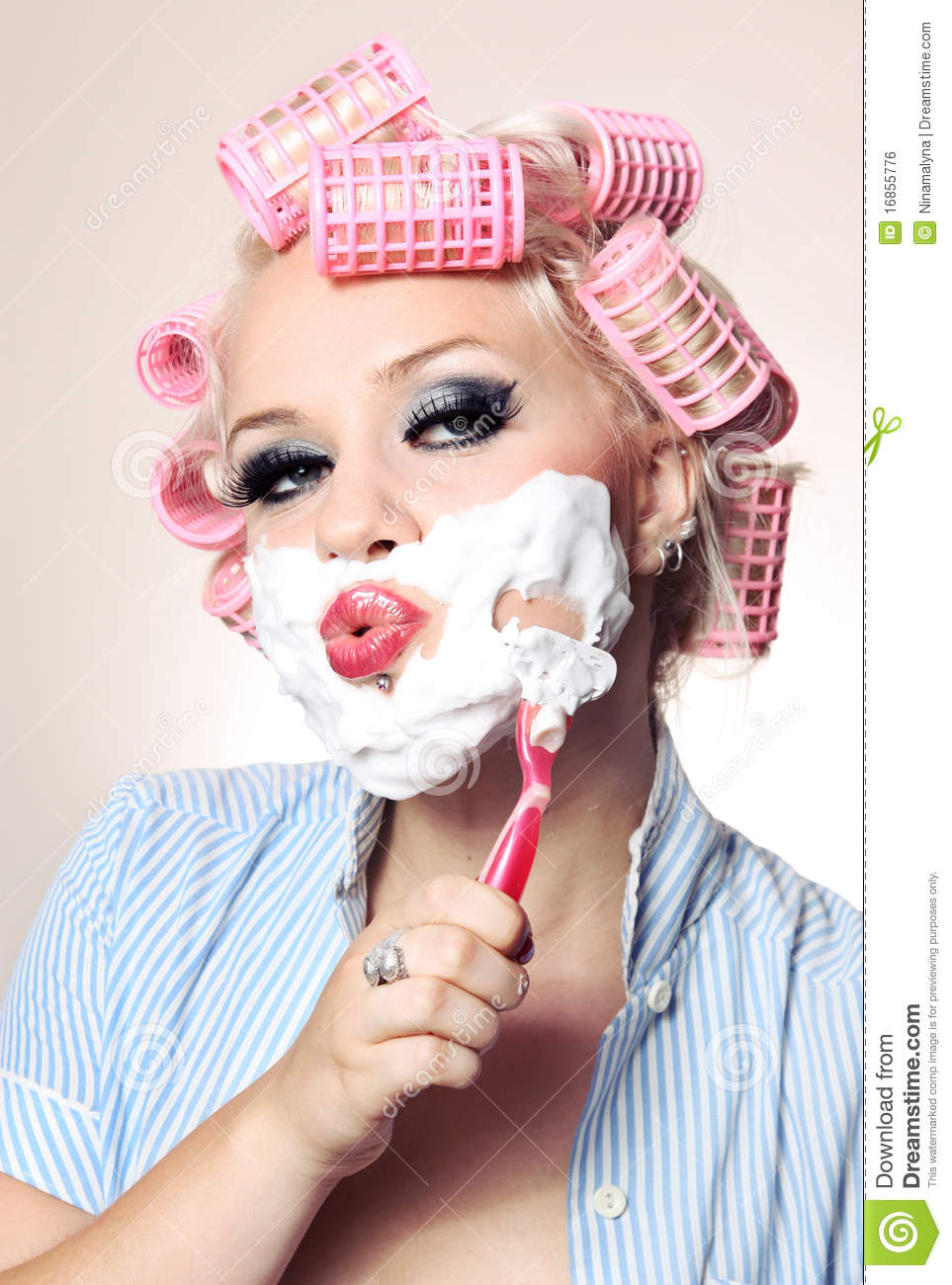 Attractive girl is having a shave