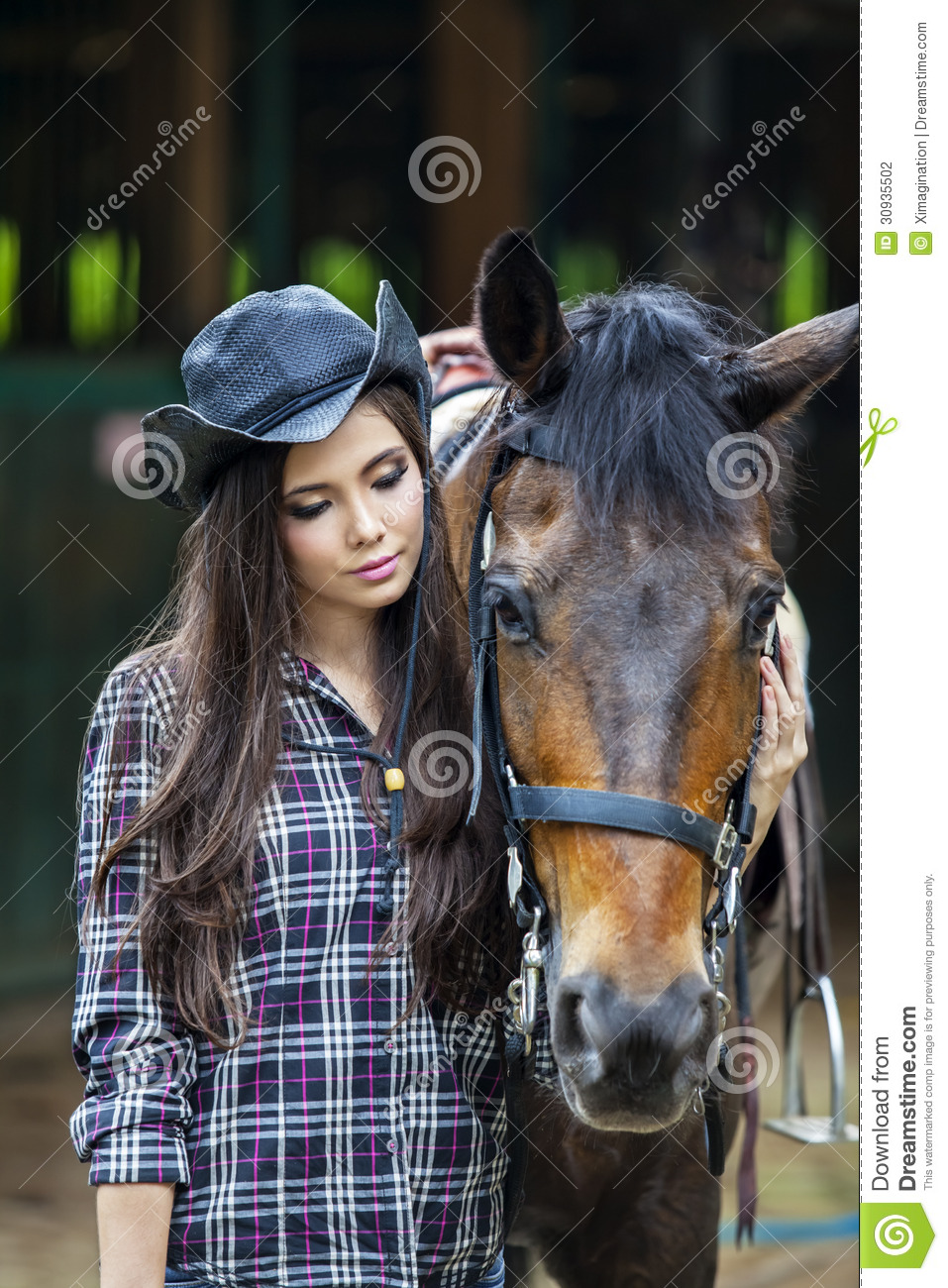 Attractive girl with horse