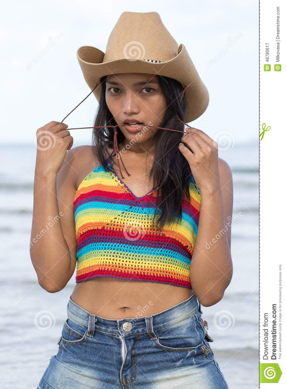 134cfdc819779 Attractive girl in the sea with cowboy hat. More similar stock images