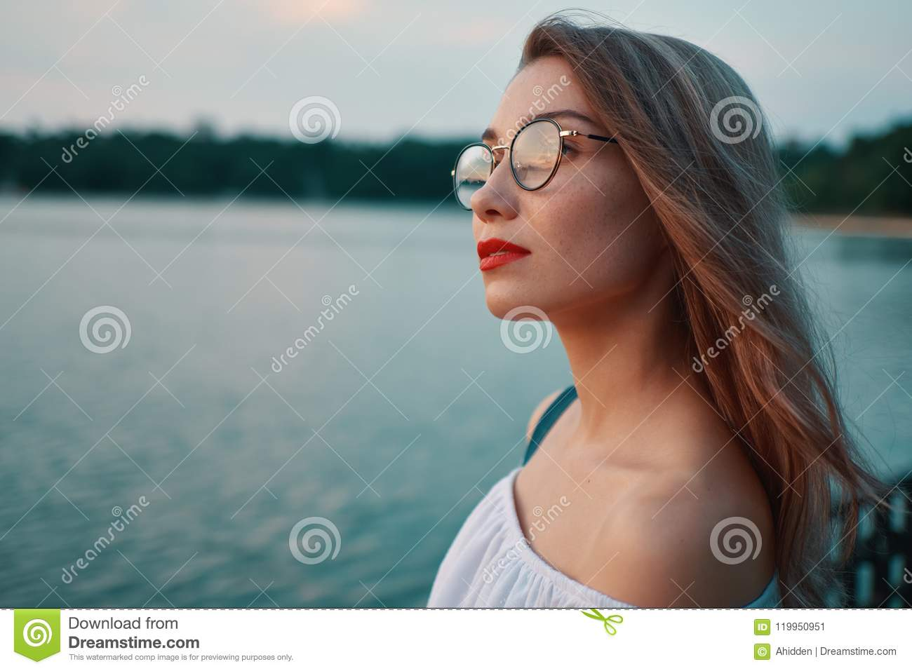 Attractive Girl Wearing Glasses On Park Lake View Stock