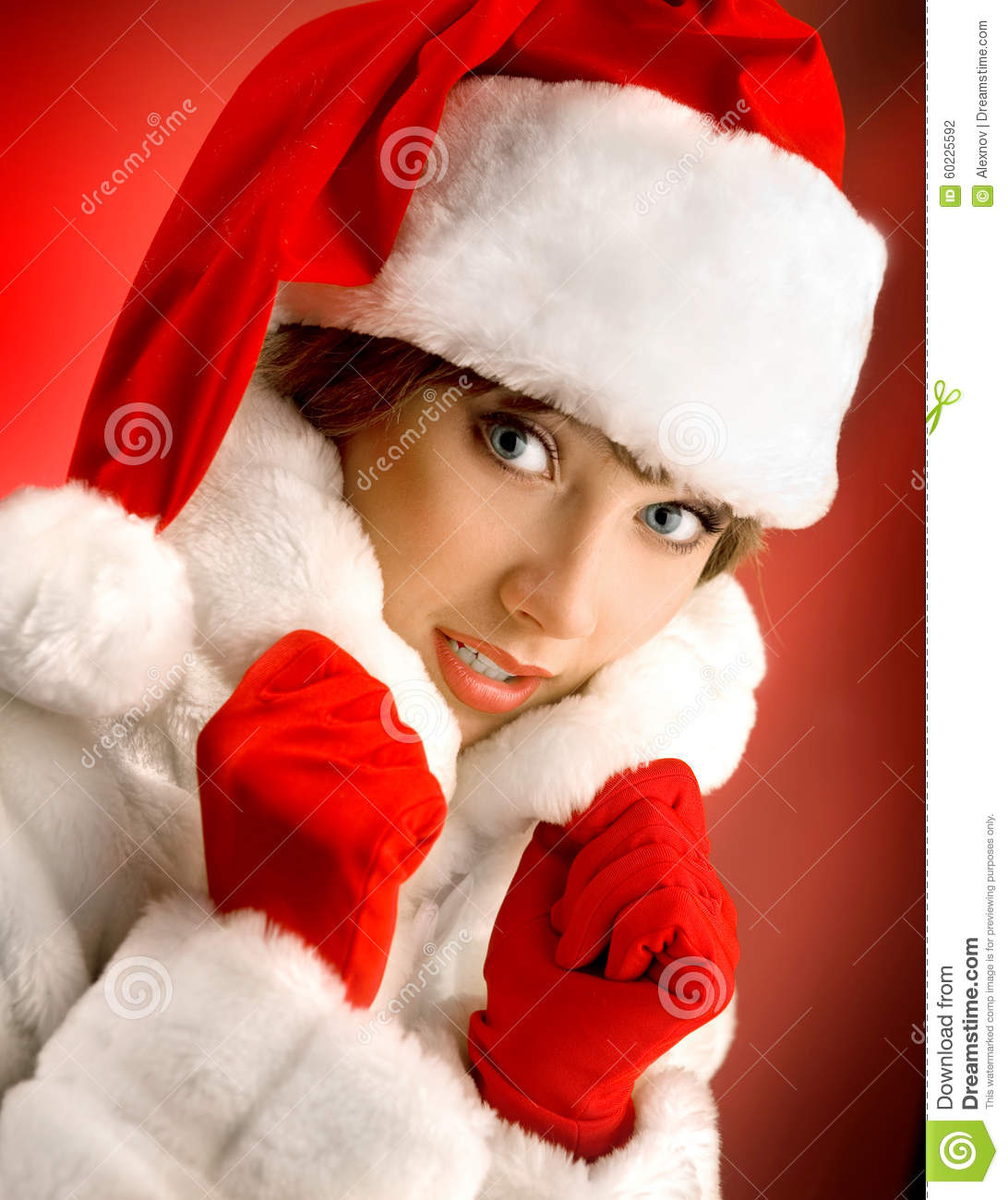 f4b9b1efbed4 Attractive Girl In A White Fur Coat And Santa Claus Hat On The R ...