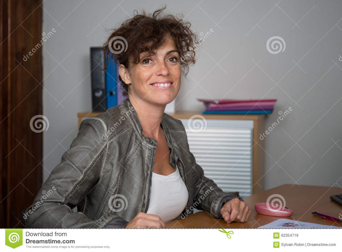 Attractive and happy business woman working on computer