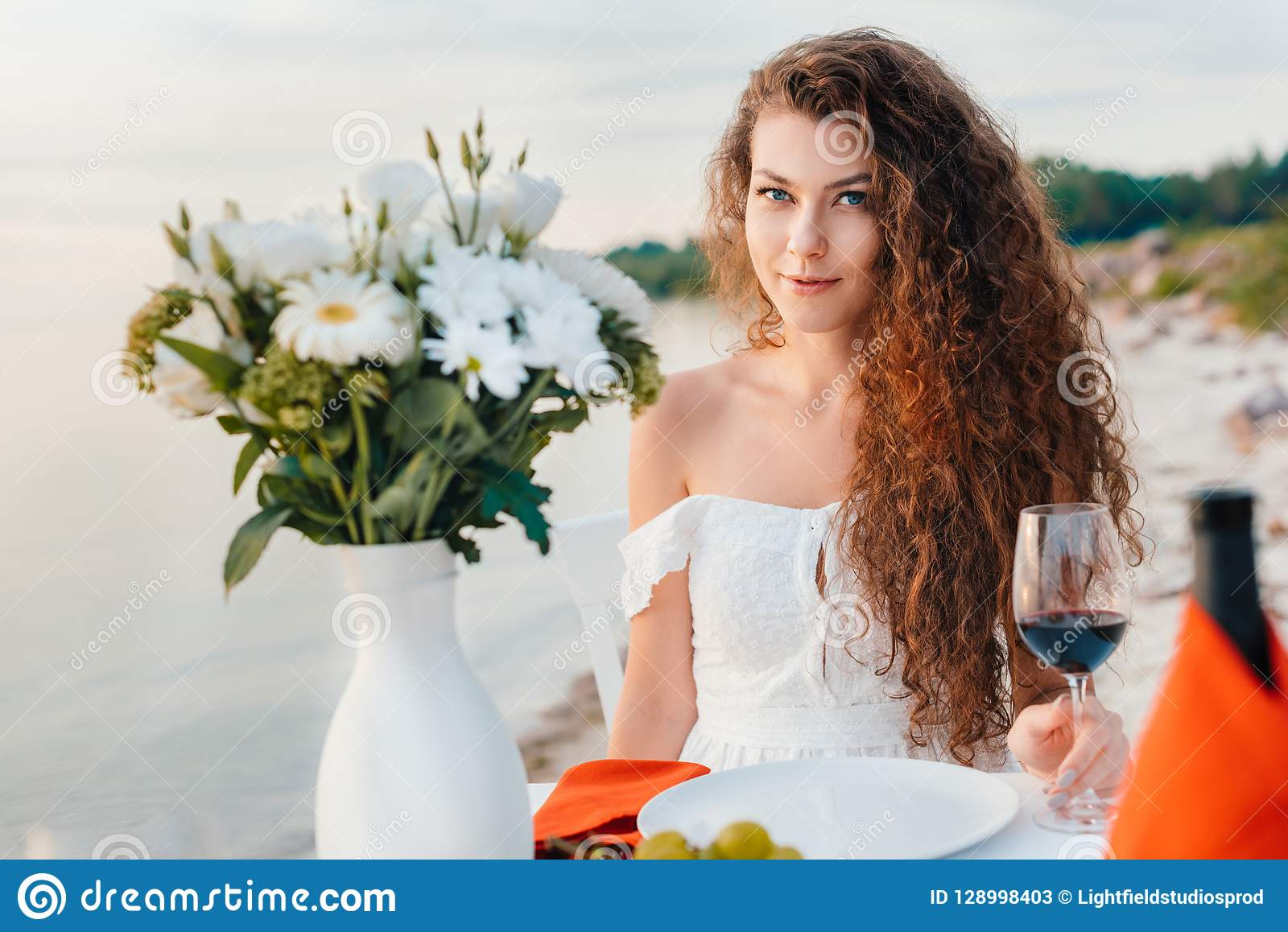 attractive happy girl with glass on wine on romantic date