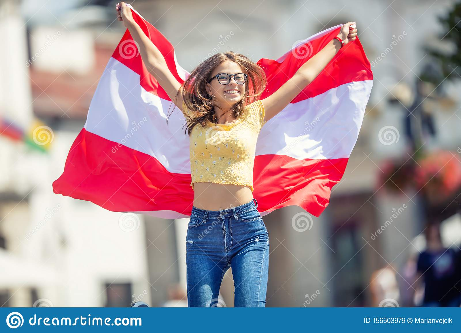 Attractive happy young girl with the Austria flag