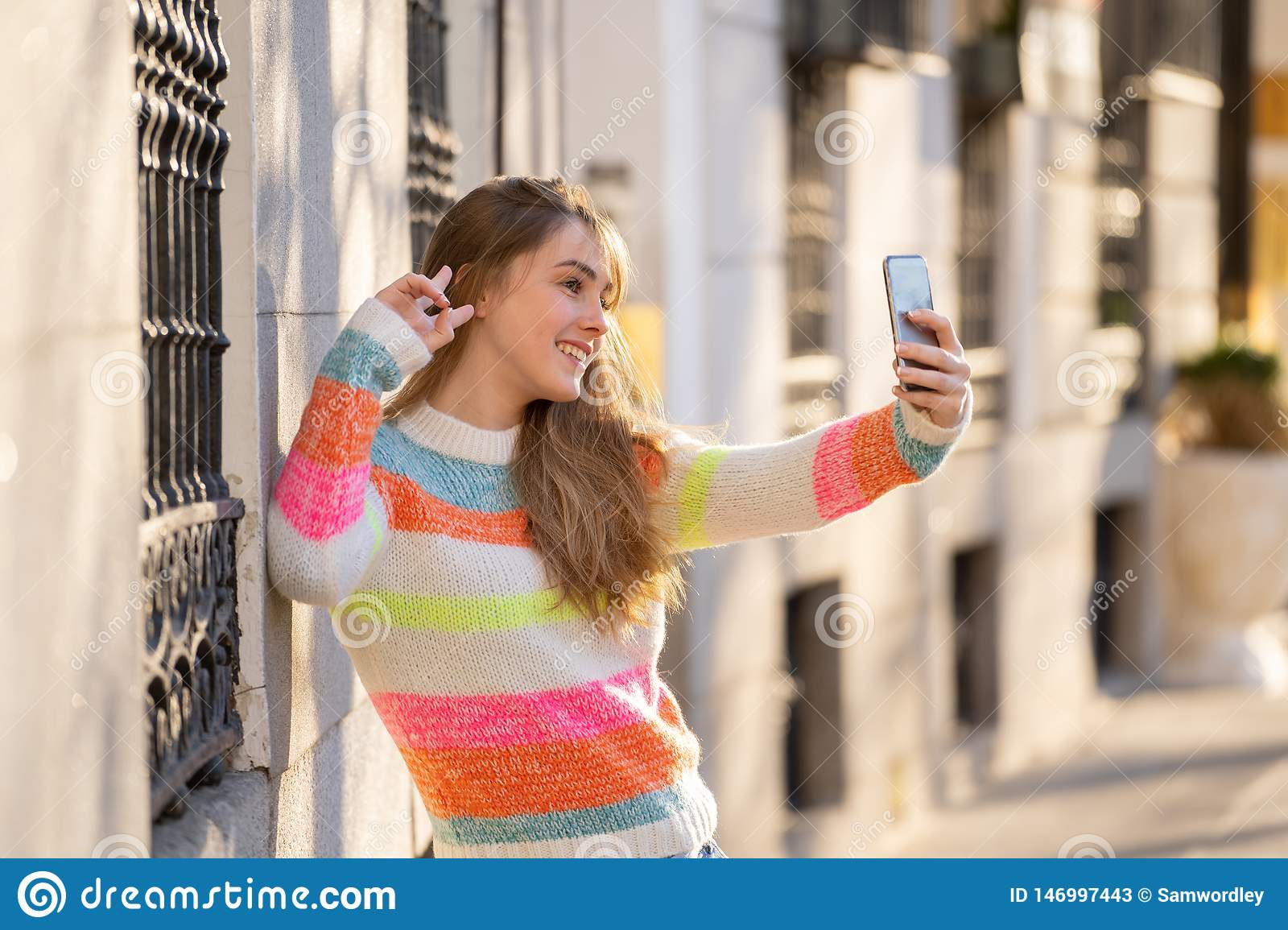 Young sporty woman taking a selfie with mobile phone at
