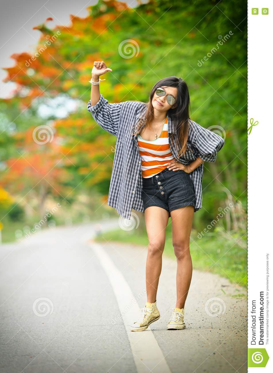 An Attractive Hitchhiker Girl Stock Photo - Image Of Fashion, Clothing 25125098-6365