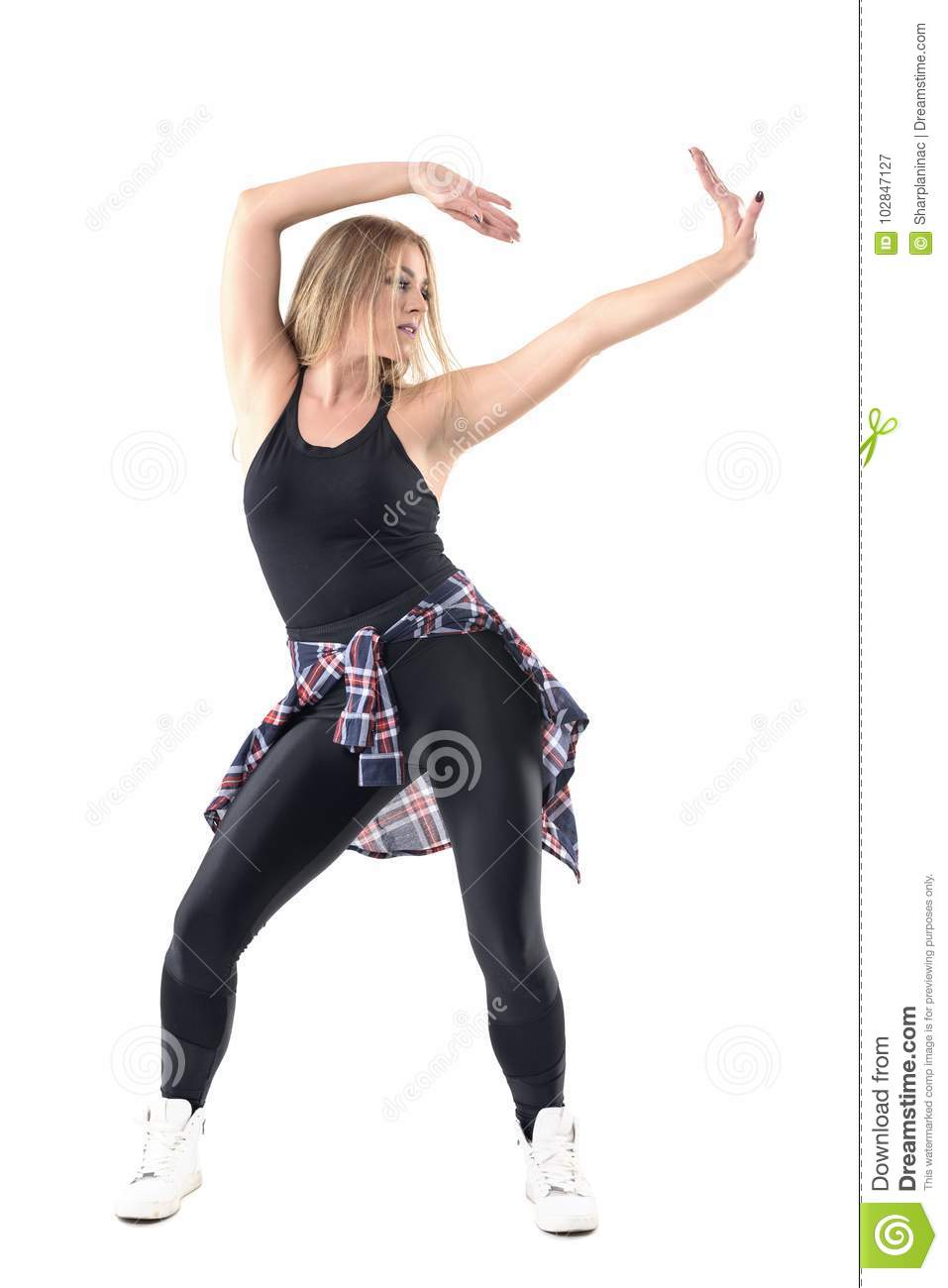 Attractive jazz dance or dancehall female dancing with arms up looking away