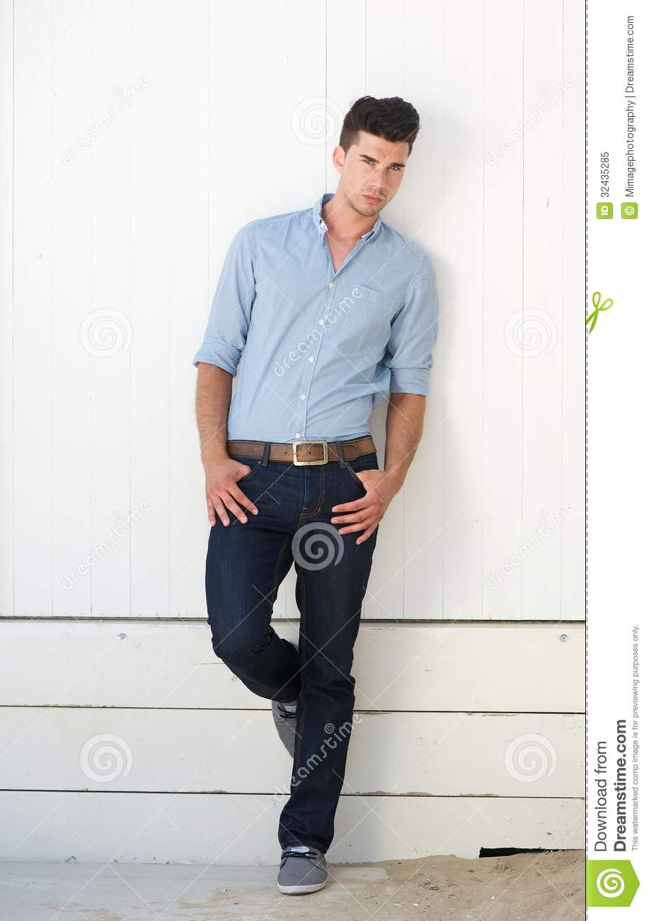 Attractive Male Fashion Model Standing Against White Wall Outdoors Stock Image Image 32435285