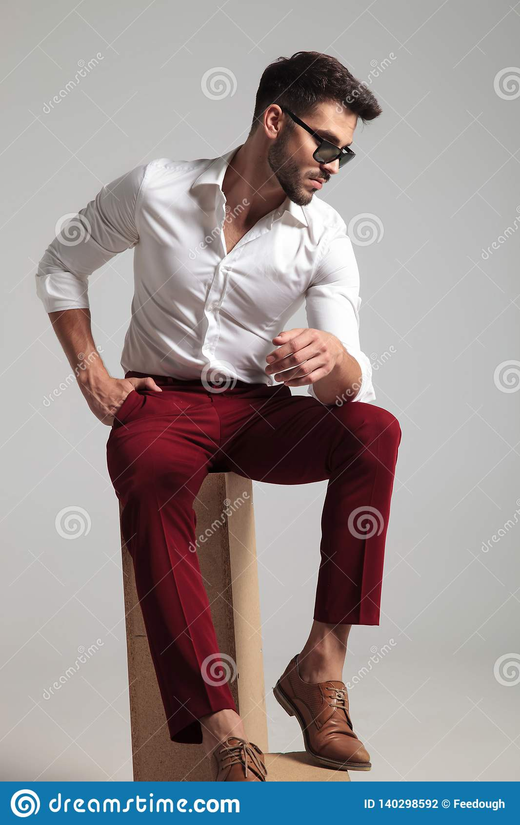 Attractive Man Poses With Hand In His Pocket Stock Photo Image Of Pants Dramatic 140298592