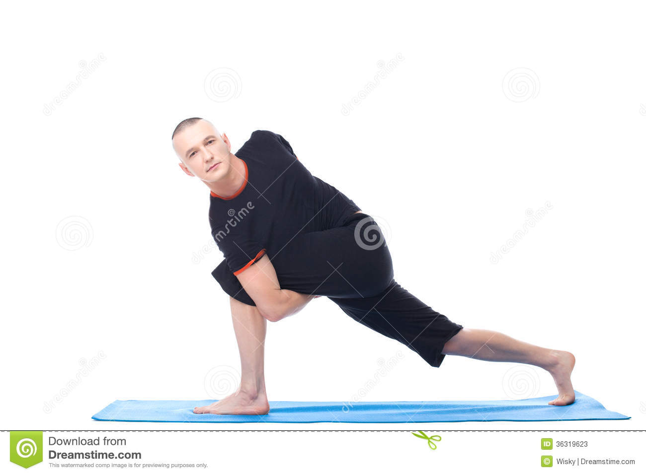 Attractive Man Posing In Difficult Yoga Position Stock