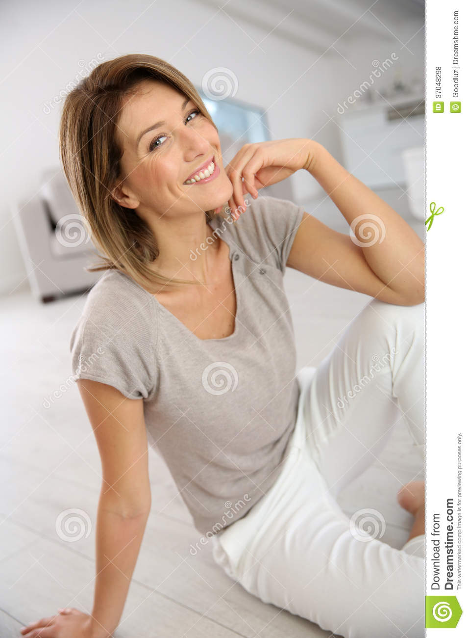 attractive middle aged woman smiling relaxing home 37048298