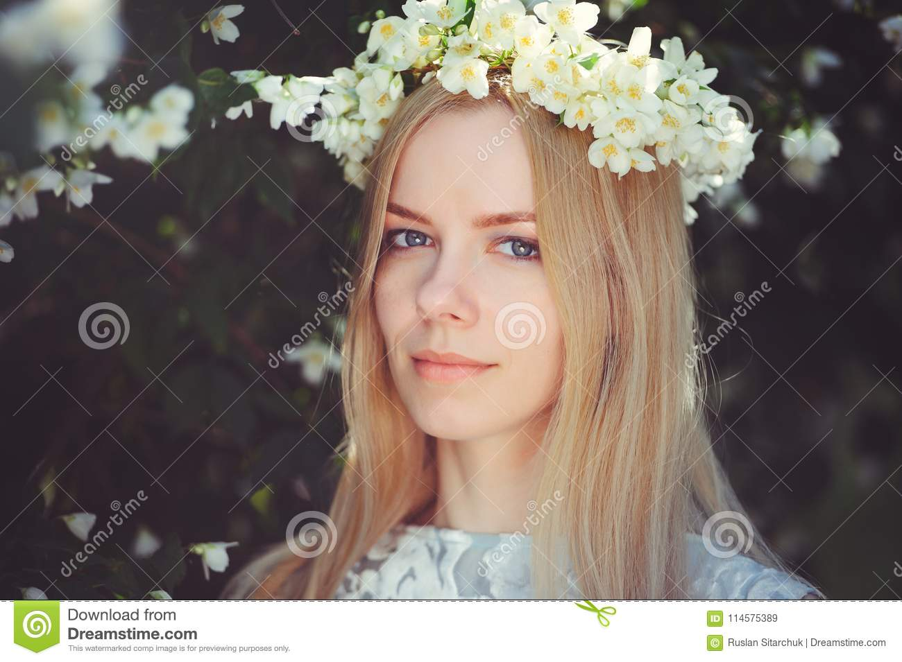 Attractive modest young girl with blonde with jasmine flowers wreath attractive modest young girl with blonde with jasmine flowers wreath on head long hair and natural izmirmasajfo