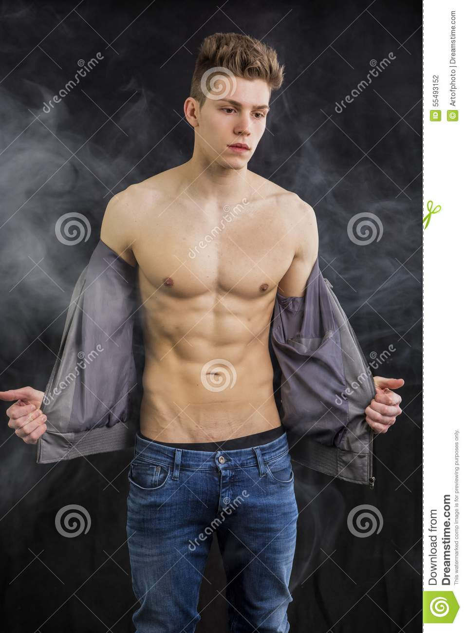 Attractive Muscular Trendy Young Man Undressing Stock