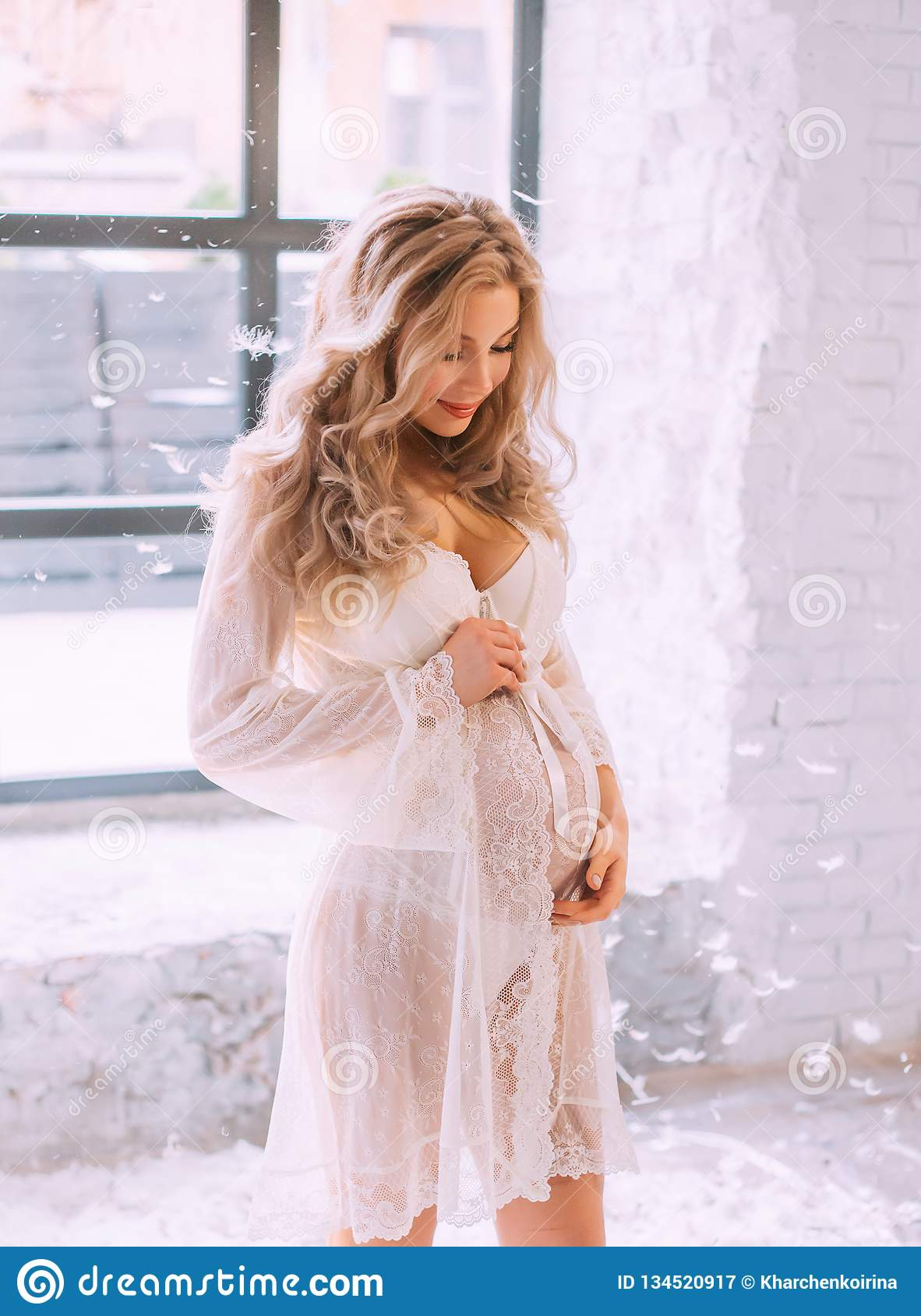 Attractive Pregnant Girl With Blomd Curly Hair In Elegant