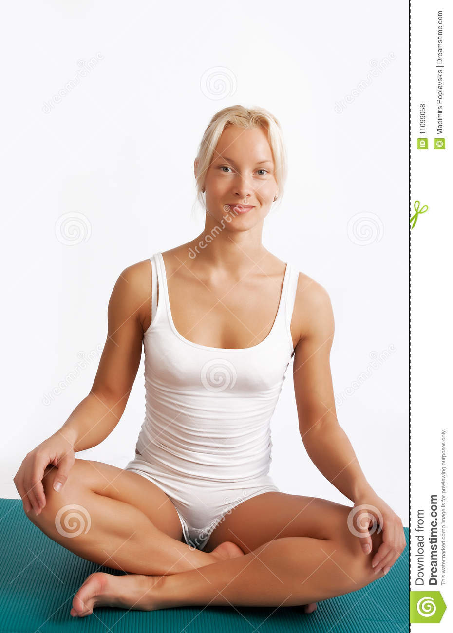 Attractive Relaxed Girl Sitting On Mat Stock Photo Image
