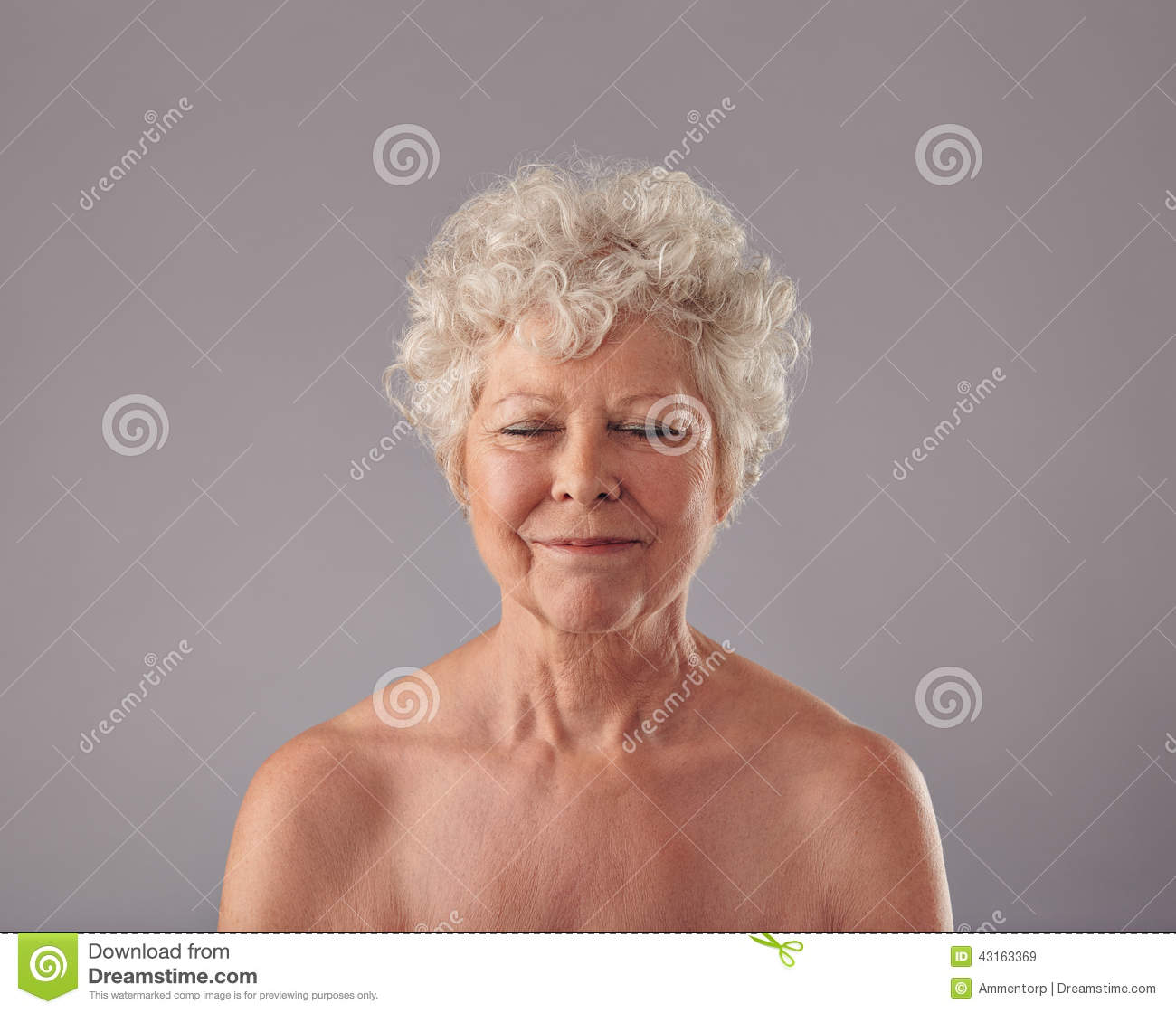 Attractive Senior Woman With Her Eyes Closed In Thought Stock Photo ...