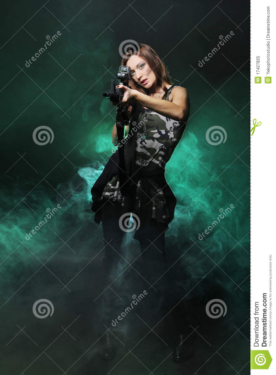 Attractive and army girl with assault rifle