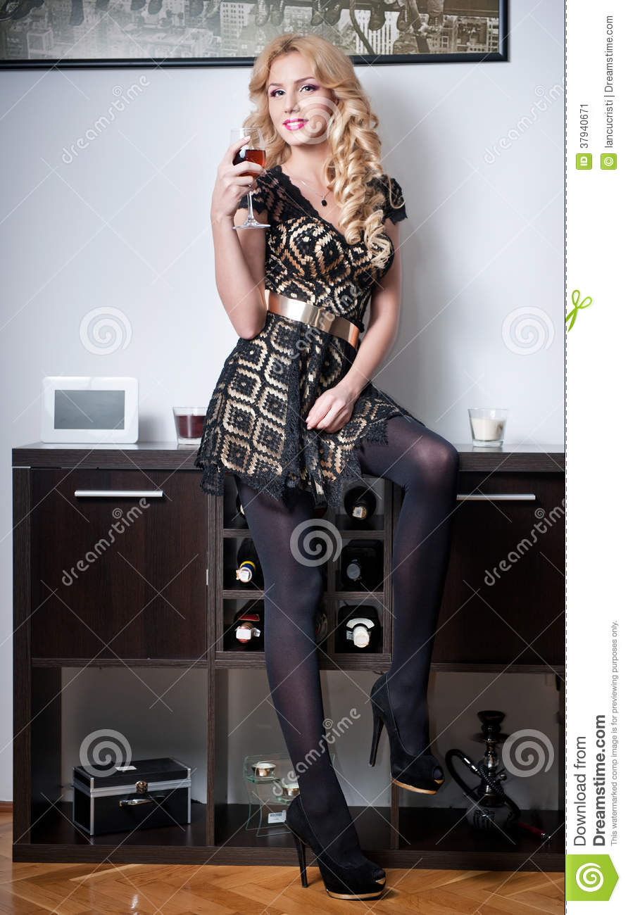 Attractive Blonde Female Wearing Black Dress Stock Image