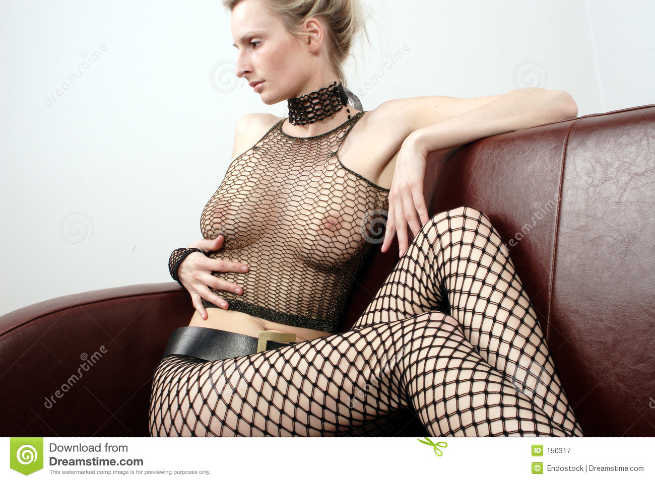 Attractive woman on leather sofa