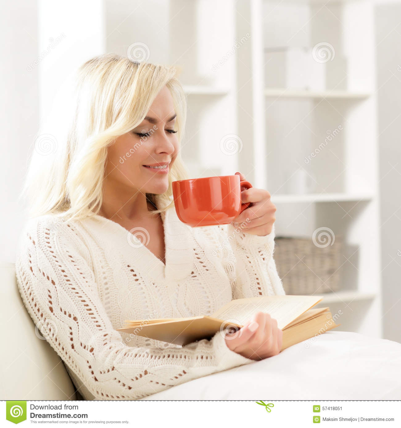 Attractive smiling happy woman reading a book
