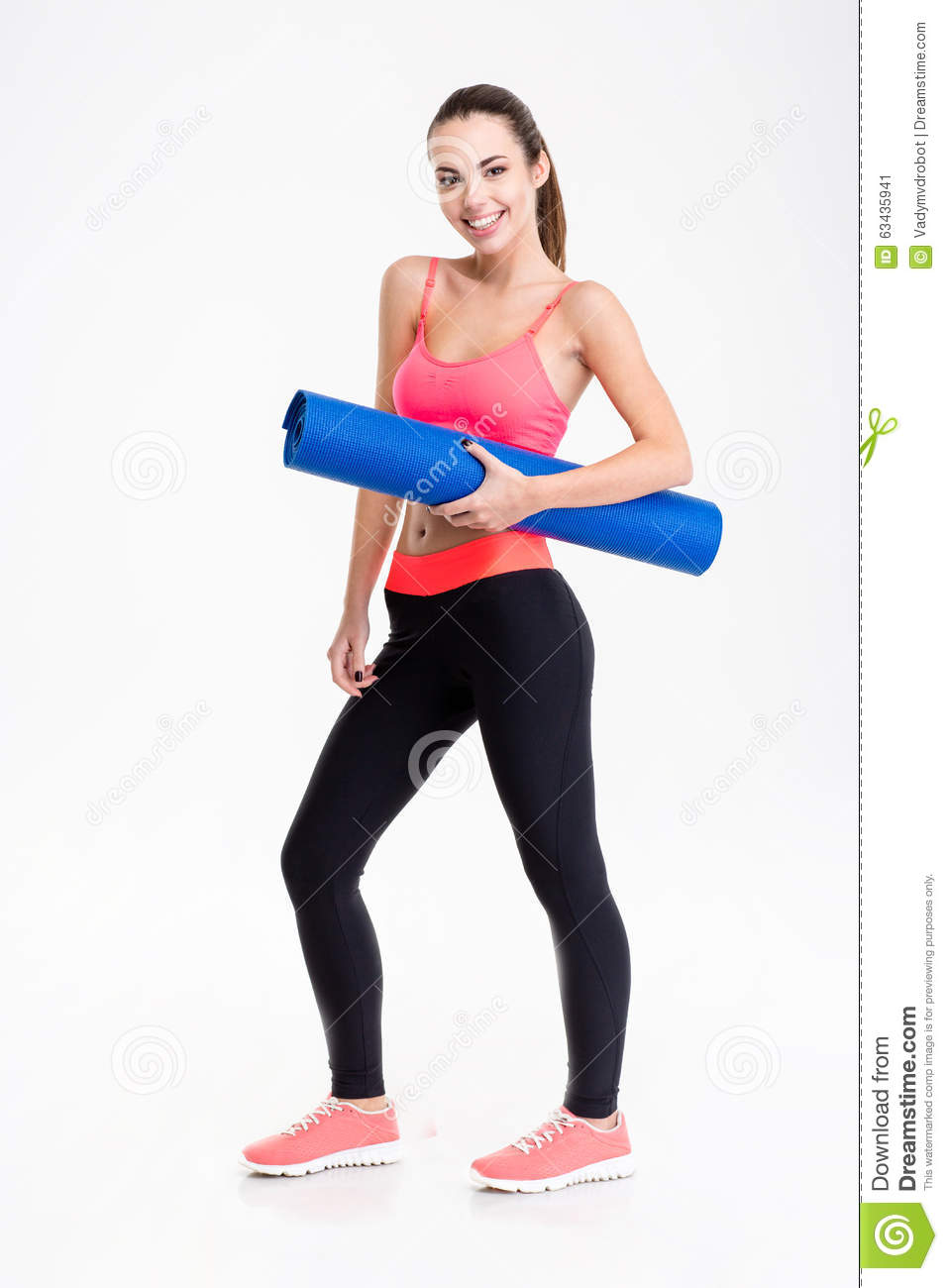 Attractive Smiling Young Fitness Woman Holding Yoga Mat