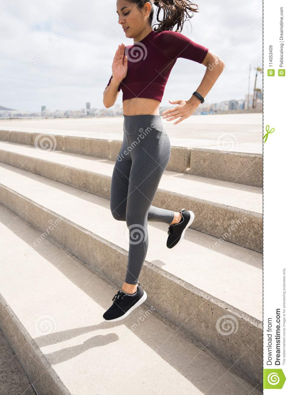 Attractive Sporty Woman Running Down Stairs Stock Image