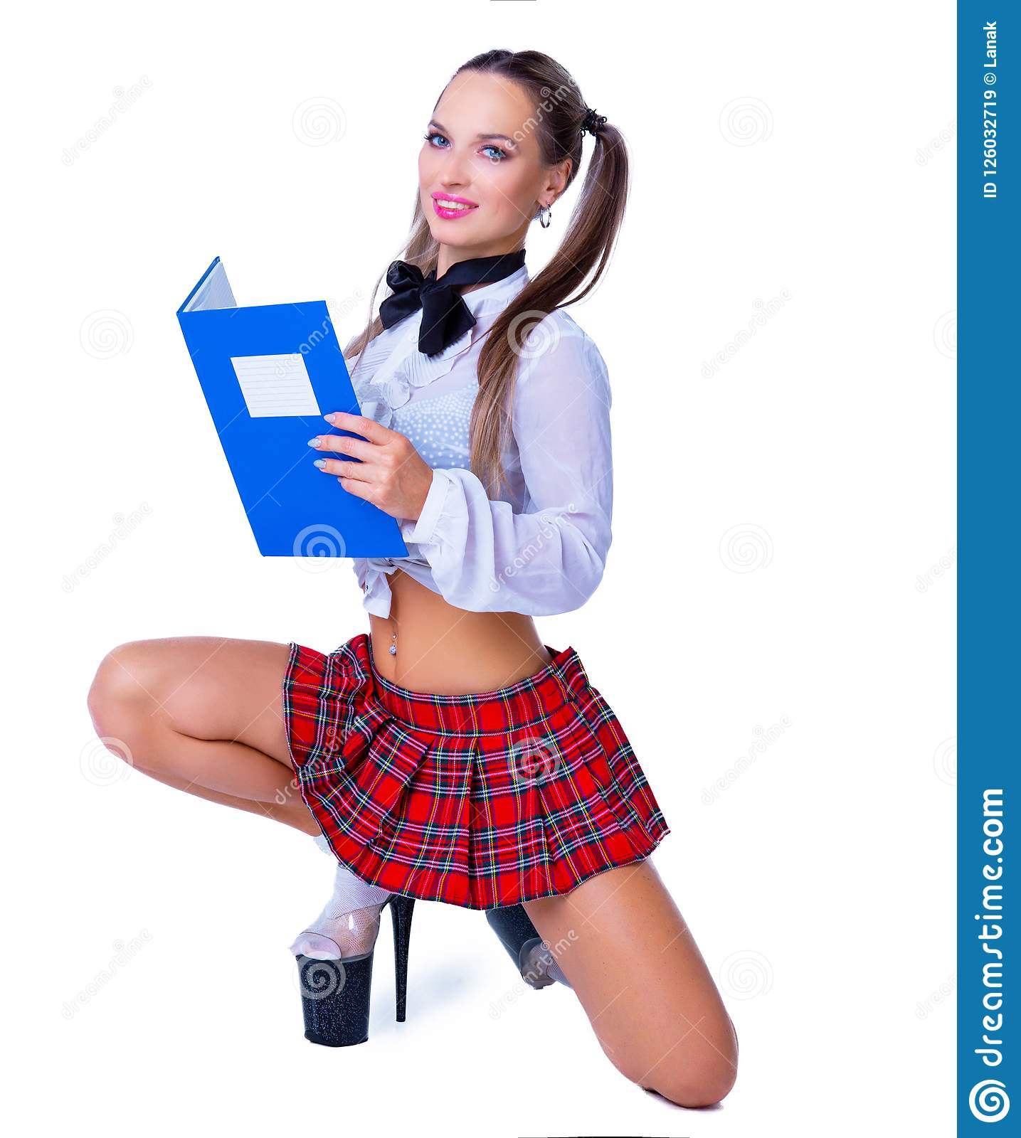 Attractive striptease dancer dressed as a schoolgirl