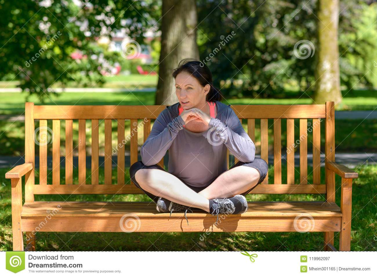 Attractive Supple Woman Sitting On A Park Bench Stock Image Image