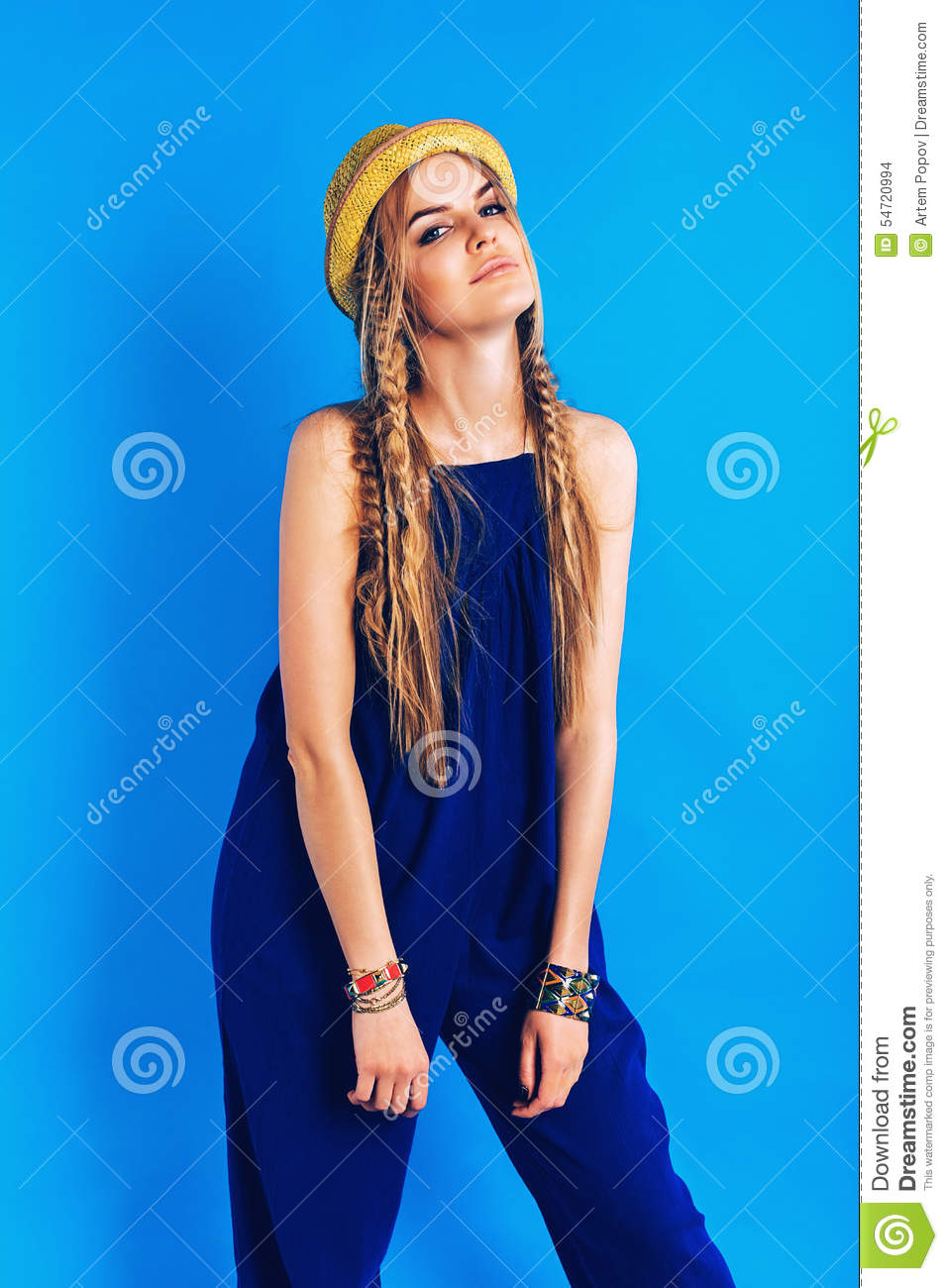 9757f4558dde Attractive Woman In Blue Jumpsuit And Straw Hat Stock Photo - Image ...