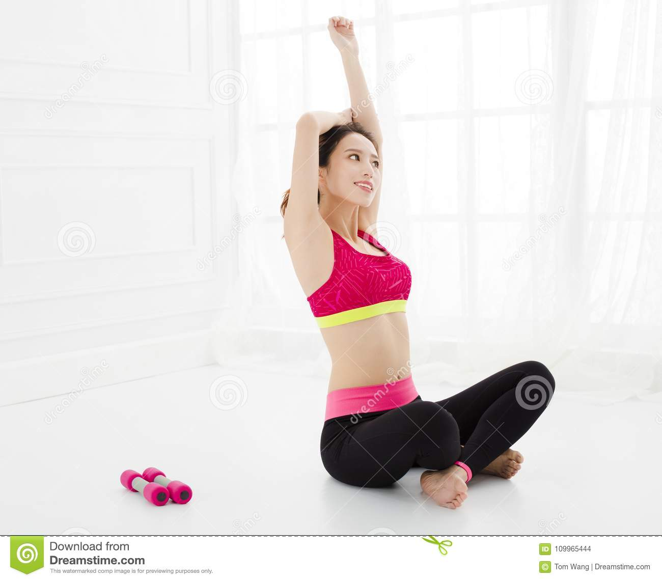 Attractive woman does yoga exercise at home