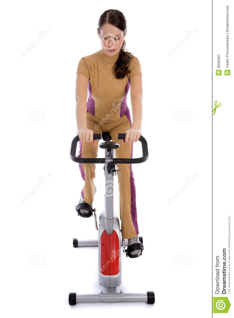 Woman Riding Stationary Bicycle In Health Club Royalty ...
