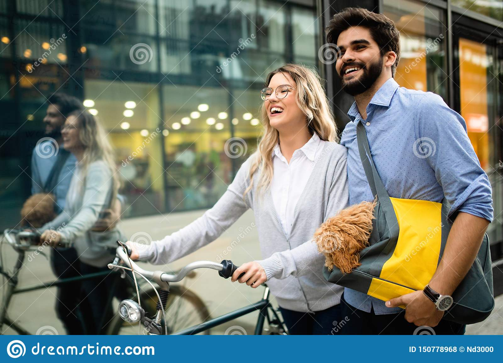 Happy young couple spending time together with dog and bicycles