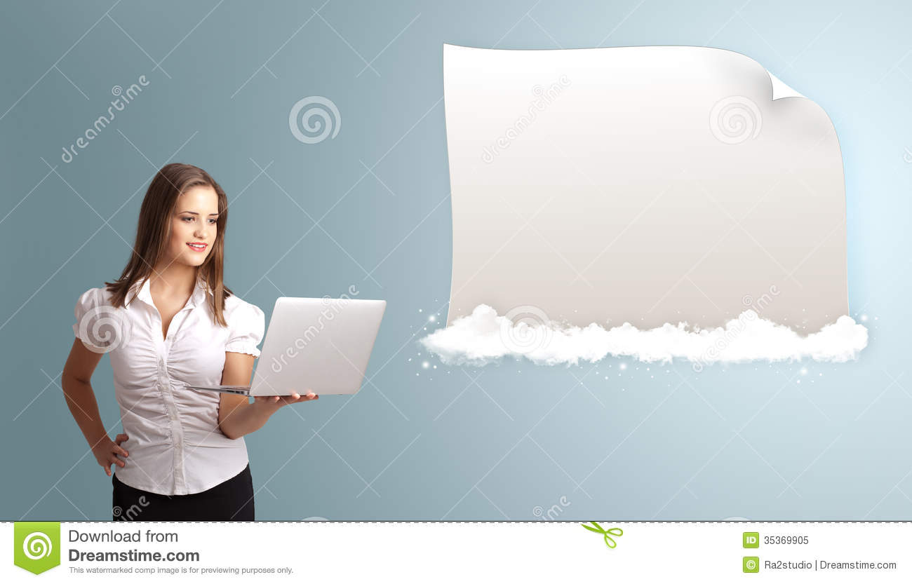 Attractive woman holding a laptop and presenting modern copy spa