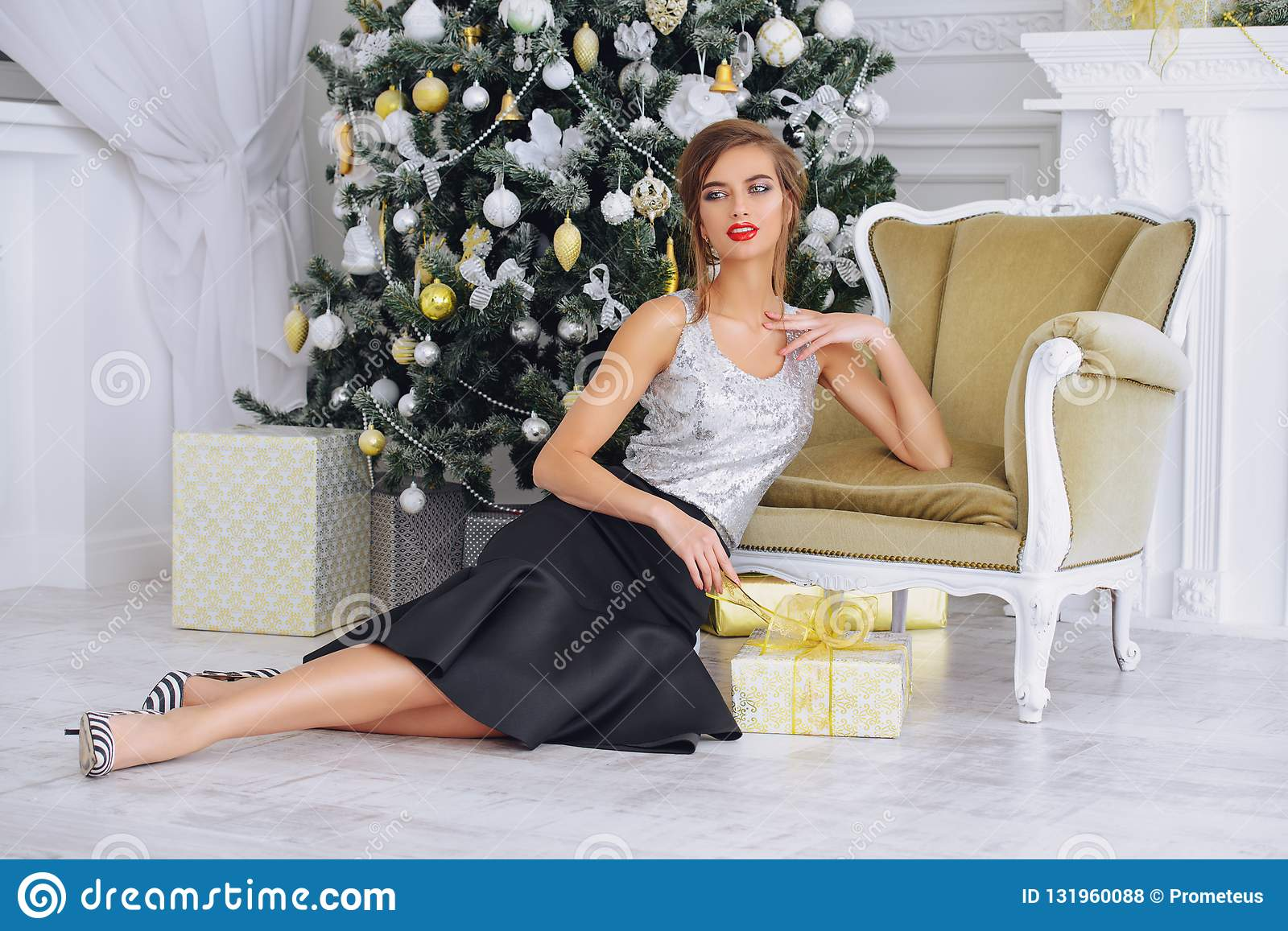 Attractive woman in interior for Christmas