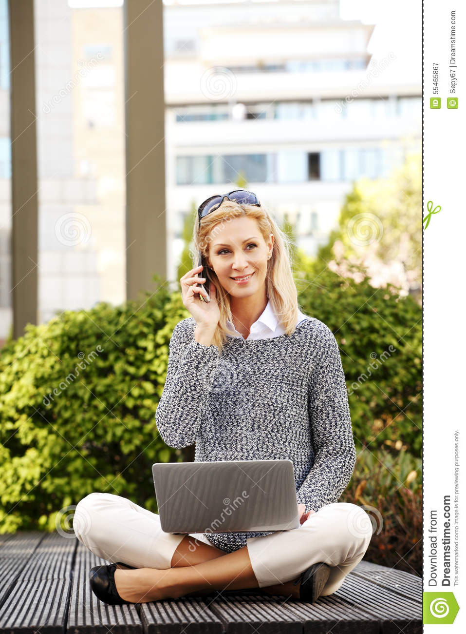 Attractive woman with laptop and handy