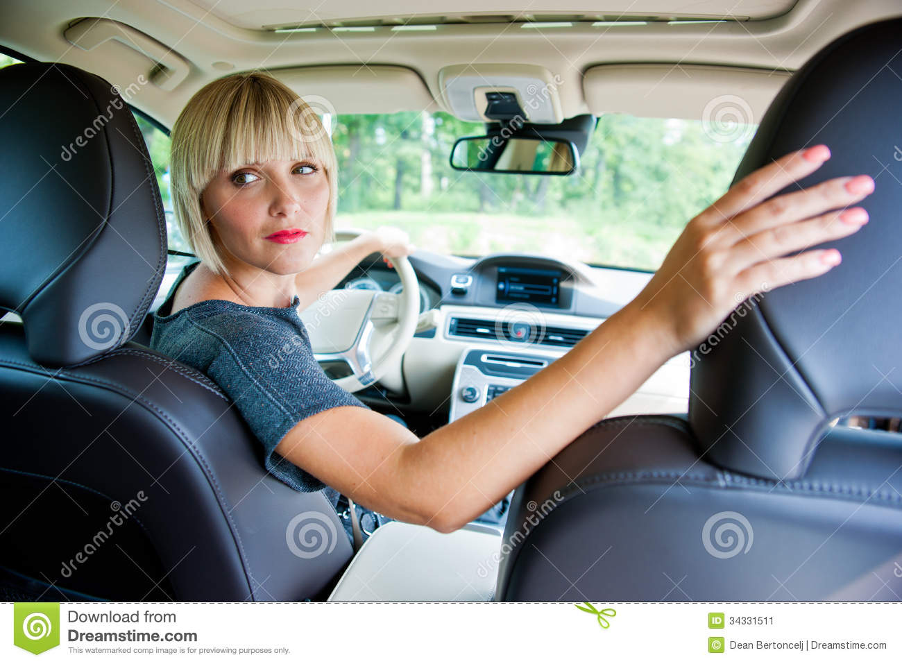 Attractive woman parking her car