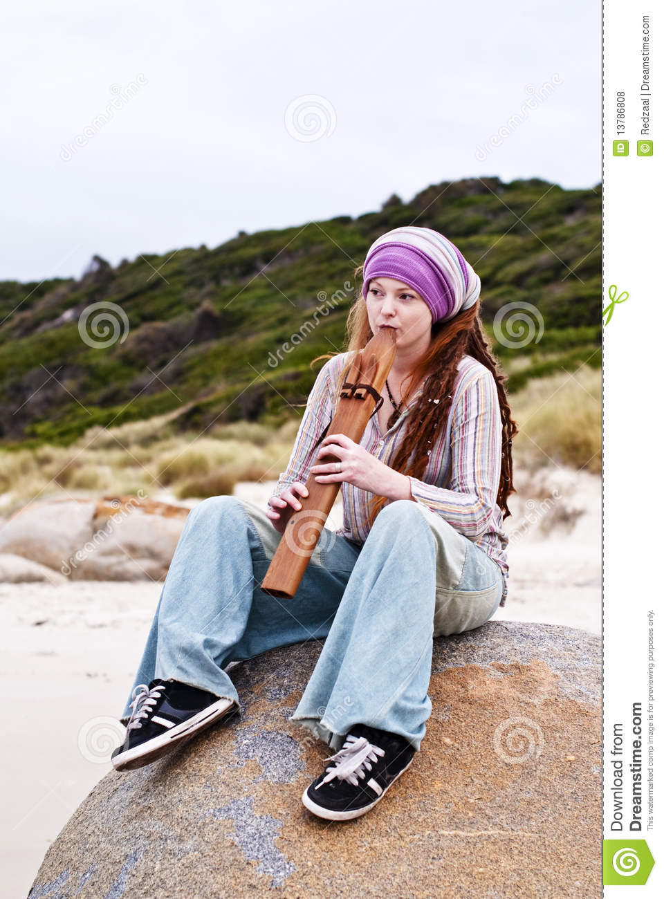Attractive Woman Playing Native American Flute Stock Photo