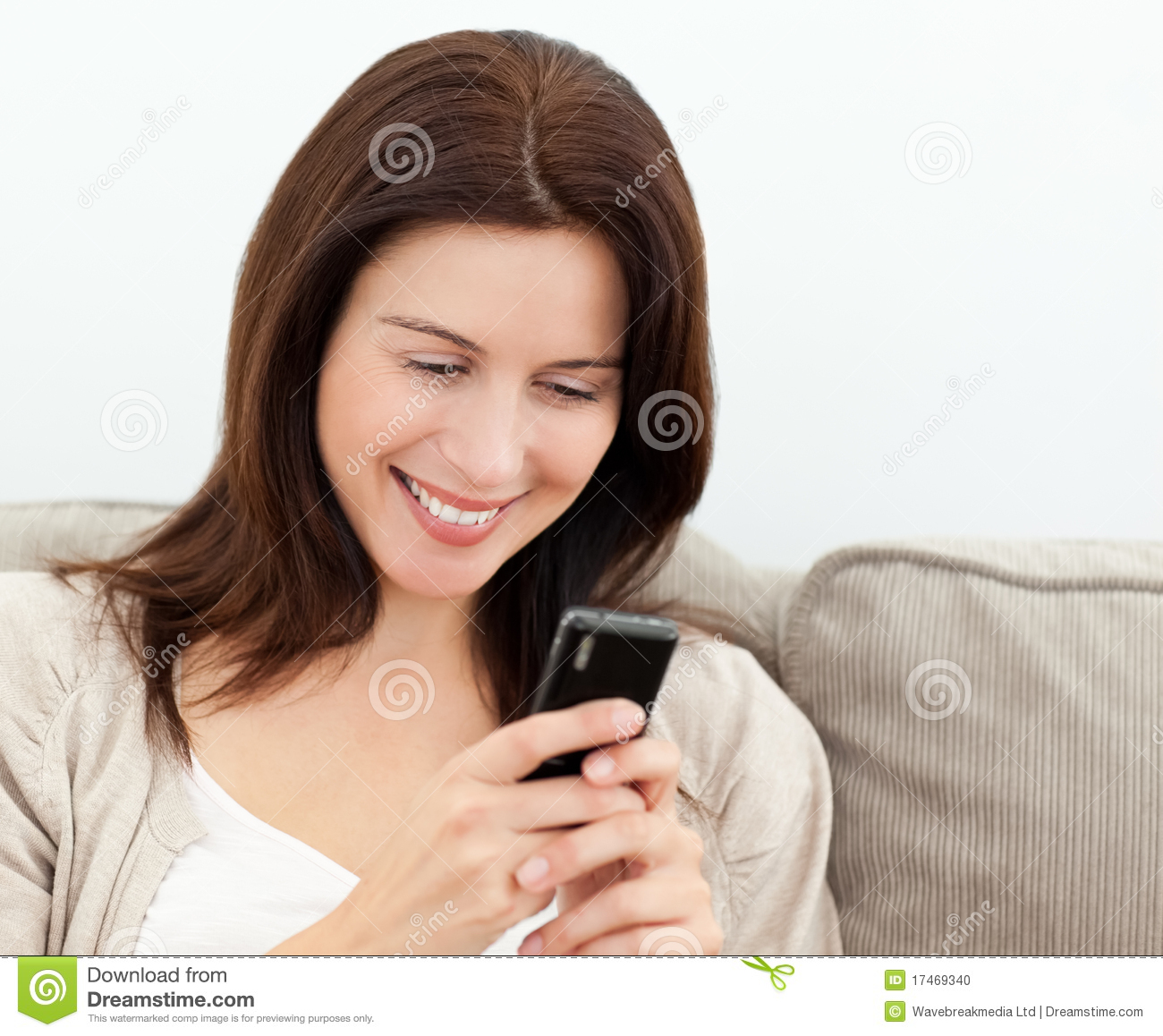 Attractive woman reading a sms on her cellphone