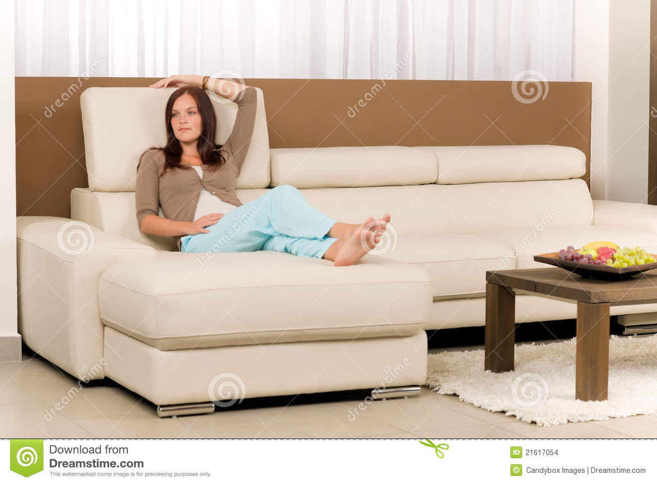attractive woman relax living room leather sofa stock images image 21617054. Black Bedroom Furniture Sets. Home Design Ideas