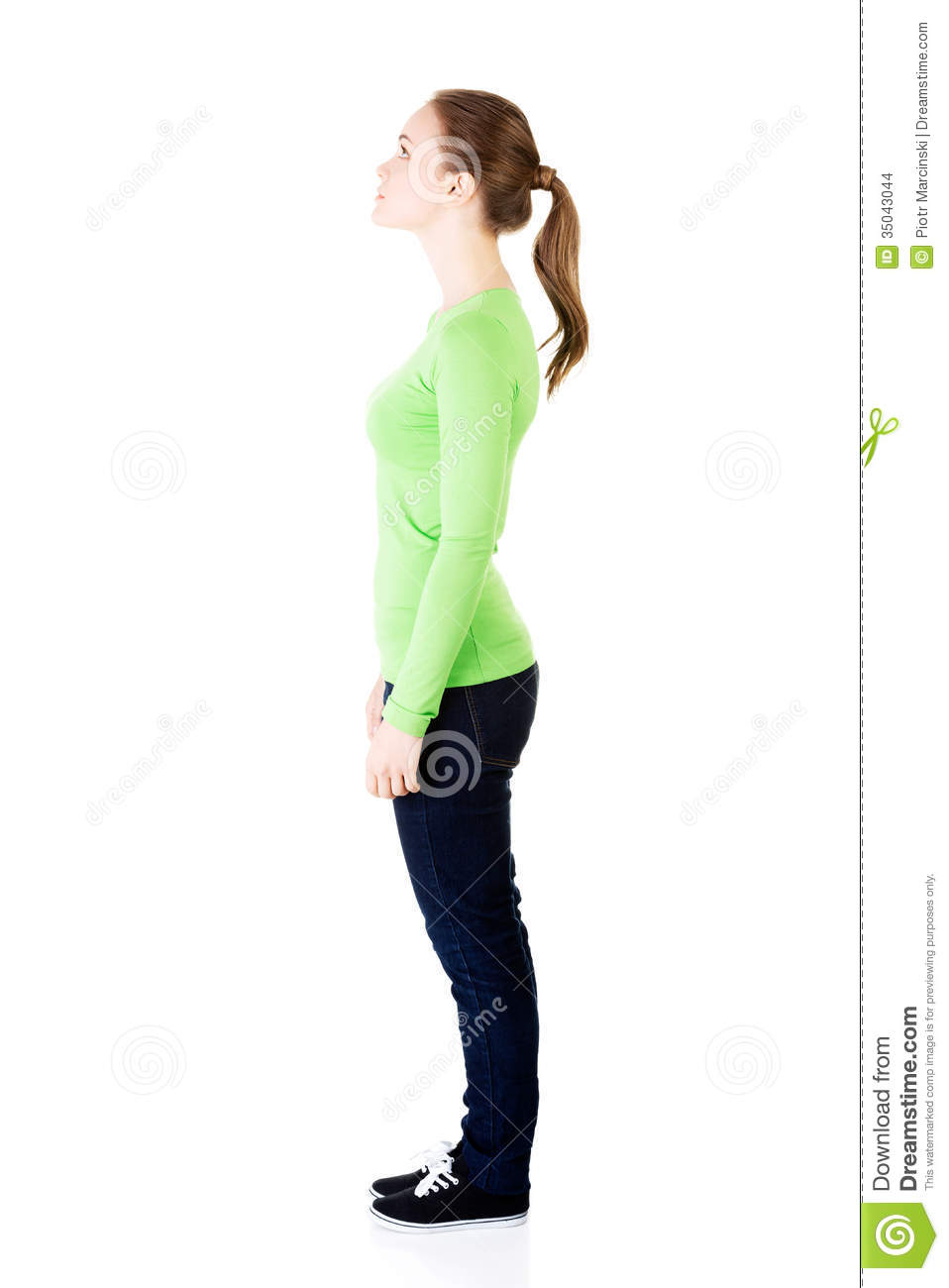 Attractive Woman Standing And Looking Up Side View Stock