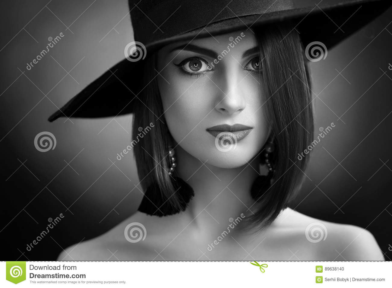 Monochrome studio close up portrait of a young elegant woman posing in a hat  on dark background cosmetics skin face lips eyes expressive confident  feminine ... e2b5b95fb54a