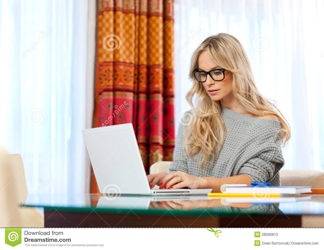 Attractive woman writing on laptop