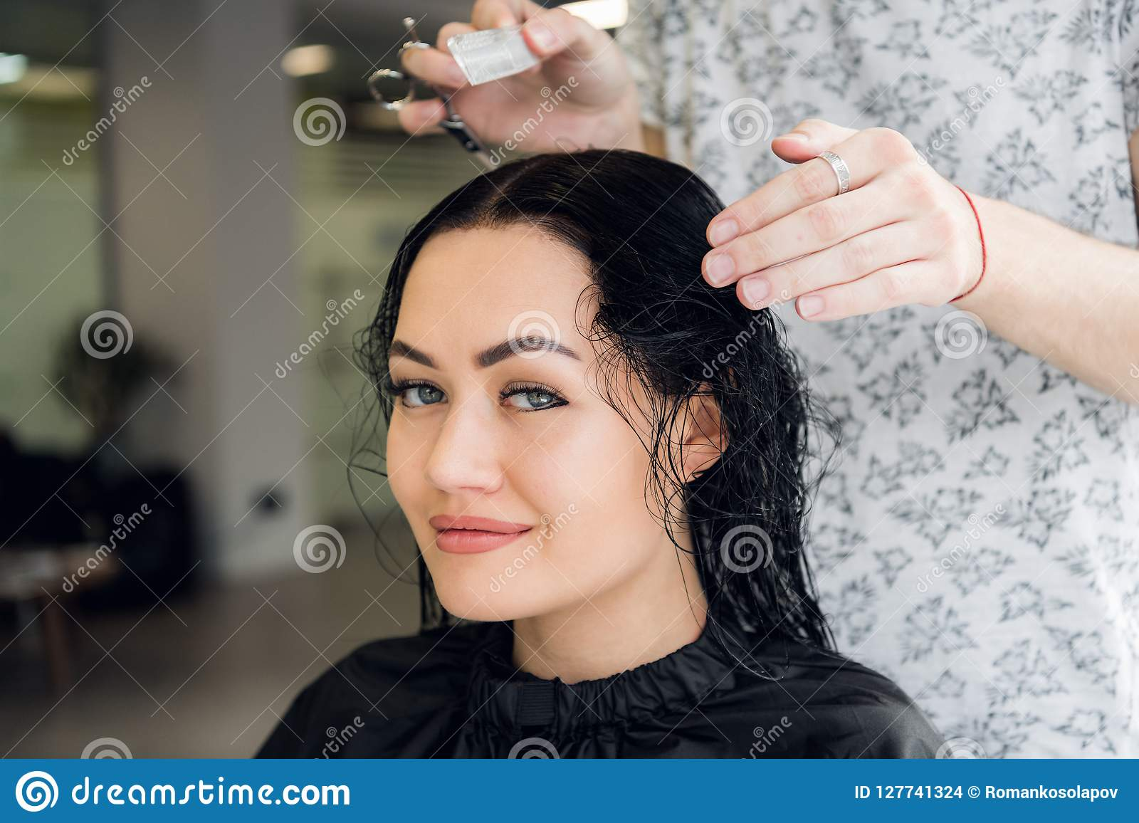 Attractive Woman Smiling While Having A Consultation With Her Hair